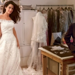 What would be the most remembered picture of the designer before his death : Amal Alamuddin's wedding dress fitting