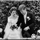 Jacqueline Kennedy wearing an Oscar de la Renta's dress for her wedding to John Kennedy